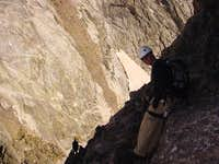 The exposed downclimb to the...