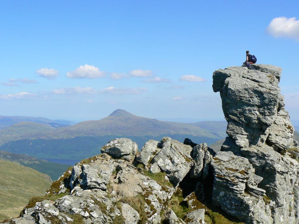 Lone climber on the summit rock