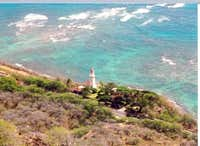 A Lighthouse and crystal blue...