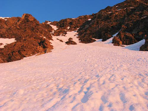 First sun rays paint snow of Dead Dog Couloir red