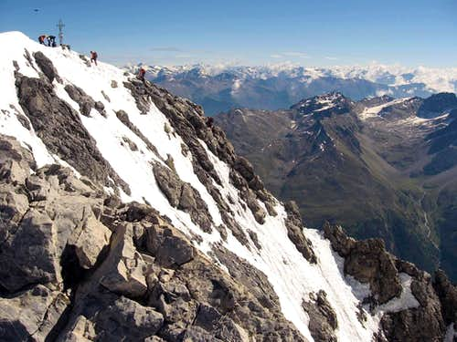 The summit, with few climbers coming up from the