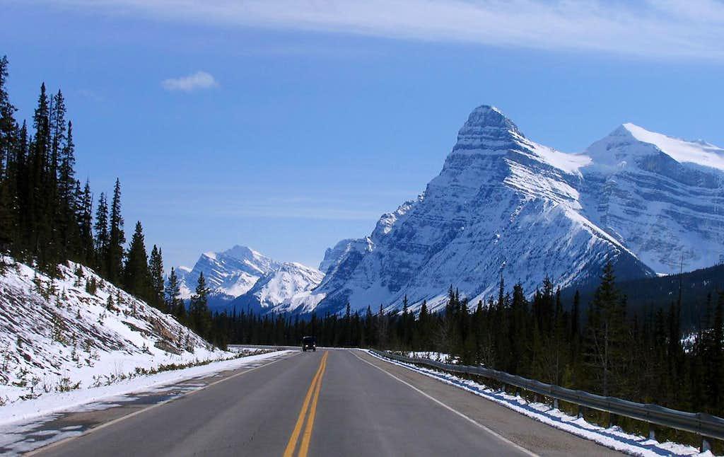 Icy peaks towering over the highway