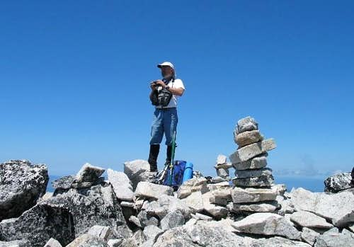 Bob next to the summit cairn...