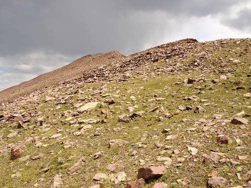 Approaching the summit in storm lighting