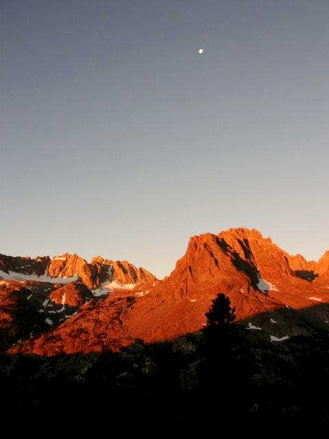Morning glow on Mt. Robinson with the setting moon