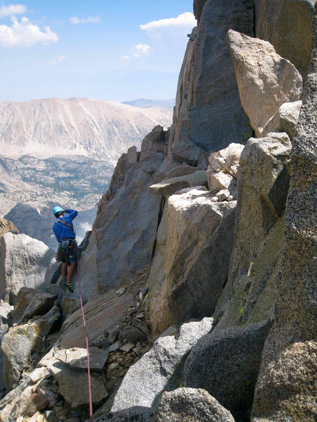 Kostas setting up the rappel on pitch 6