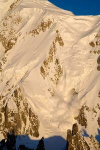 Avalanche on the Brenva face of the Mont Blanc at dawn