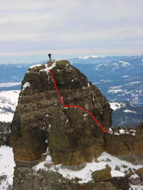 A lone climber stands atop...