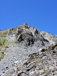 The ridge between the scree cirque and the SE chutes