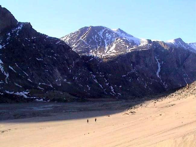 Hiking across sandy slopes on...
