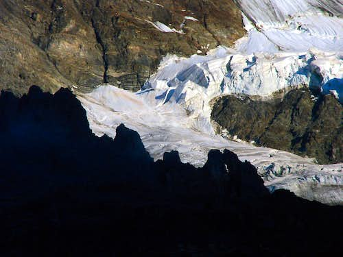 The wild seracs of the Rottal glacier in contrast to the rocks of Schwarzmönch in front of them