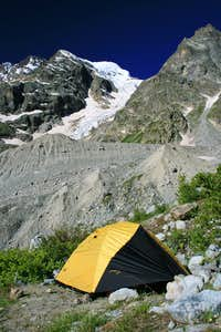 Bivouac Aristova located above the West side of the Shkhelda glacier