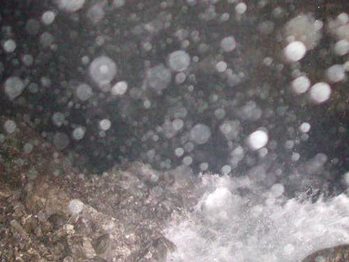 Water tumbling into the abyss of the Moon River Cave