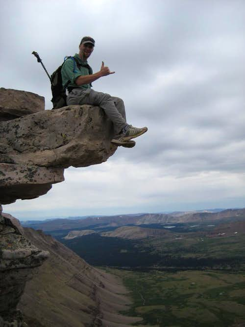 Craig on an exposed boulder below the summit