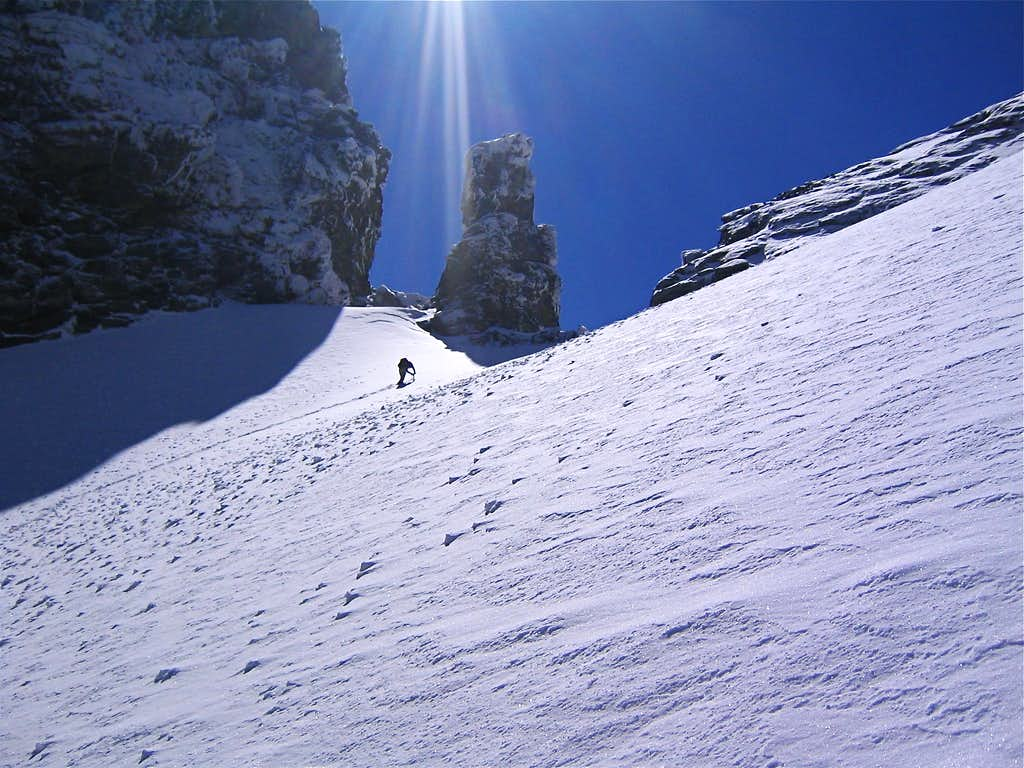Climber nearing the top of the snowfield.