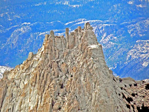 Cathedral Peak summit block with climbers on top