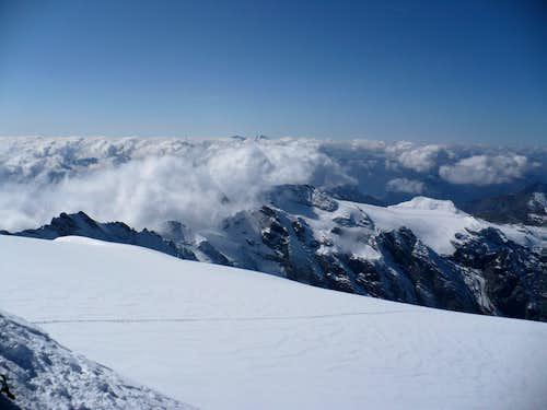 Bernina and Palu over clouds