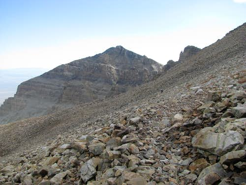 A hiker probes his way through the scree...