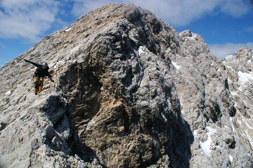 Martin fogl is balancing on the ridge. Zugspitze summit is vissible at the very rear of img.