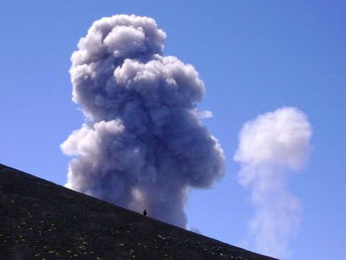 Man (tiny dot) really close to an eruption