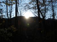Sunrise over a neighboring mountain