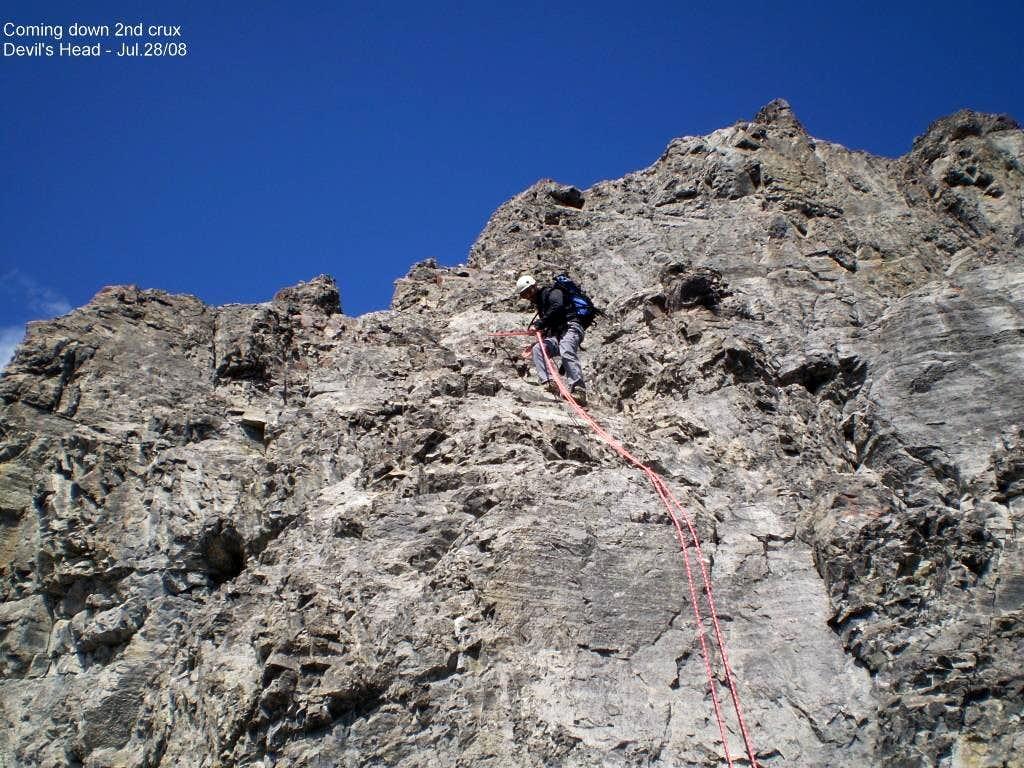 Rapelling slabby wall near summit