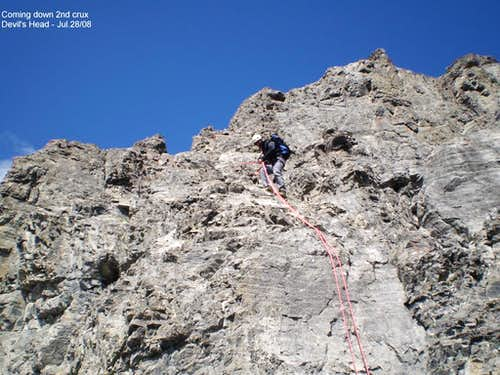 Rapelling slabby wall near summit