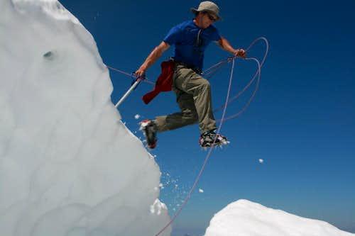 Jumping the Bergschrund just below the summit on Mt. Challenger