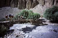 The narrow bridge crossing the big stream of the Tirich valley