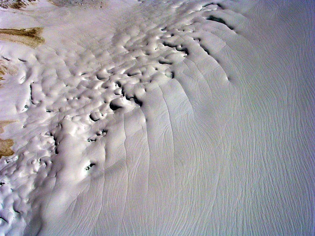Failing Snowbridges and Meltwater Channels