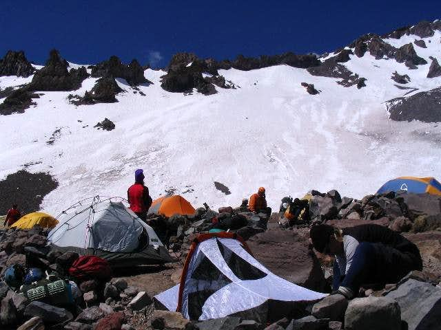 Setting up tents at Camp Helen