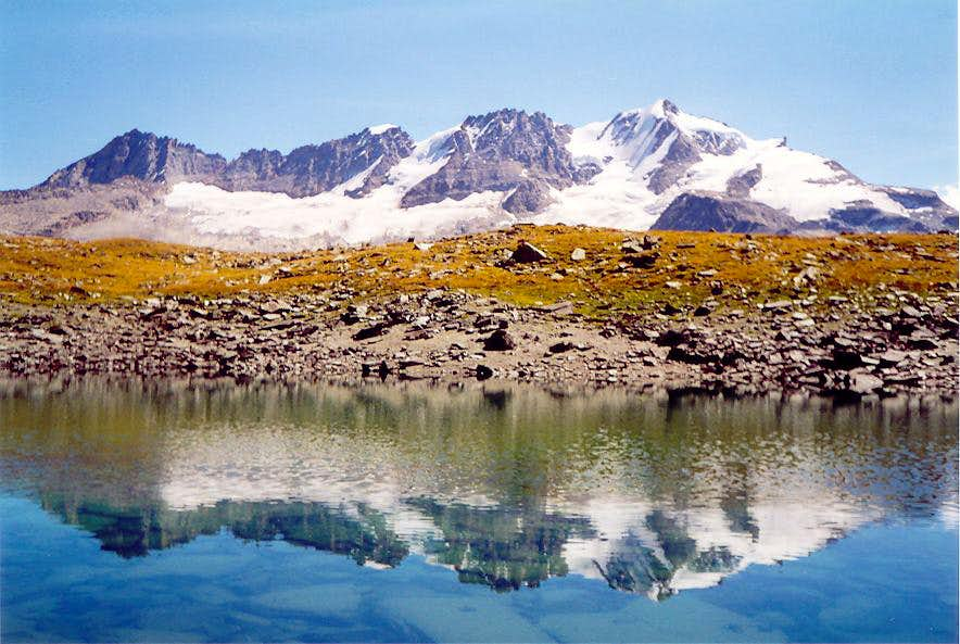 West side of Gran Paradiso chain reflected <br>into a small lake of the Vallone delle Meyes