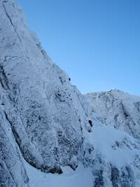 Climbers on the upper pitches of Number 3 Gully Buttress on Ben Nevis