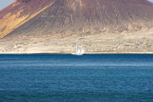 Sailing boat in front of Montaña Amarilla
