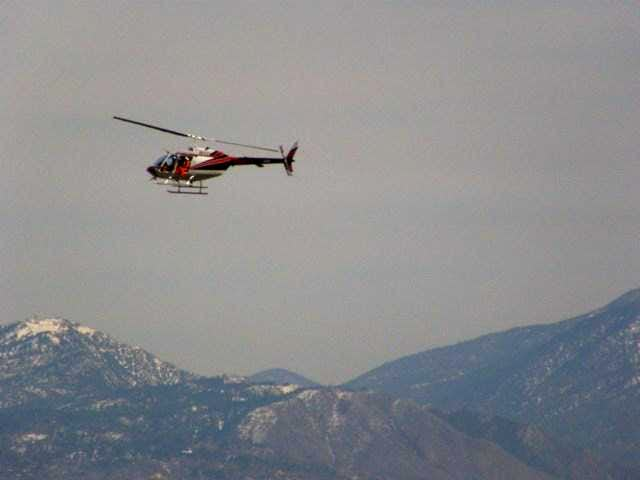 Helicopter looking for Bighorns