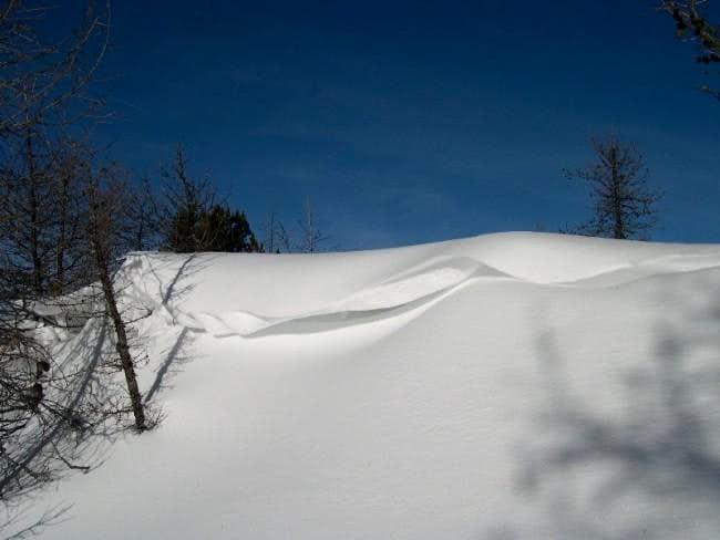 Snow narrow ledge built by...