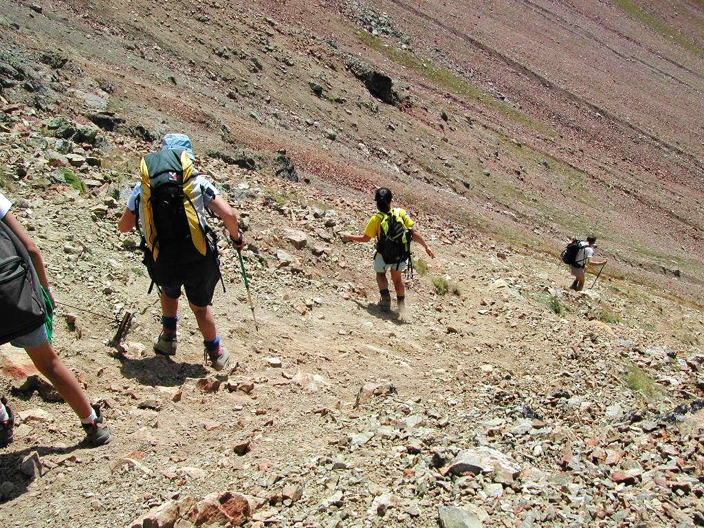 SummitPost members beginning the steep descent from Col Carrel <i>2852 m</i>