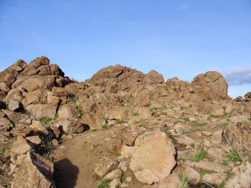 Looking up at the rocky summit of Cross Peak