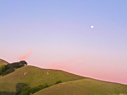 Moon over the ridge at dusk