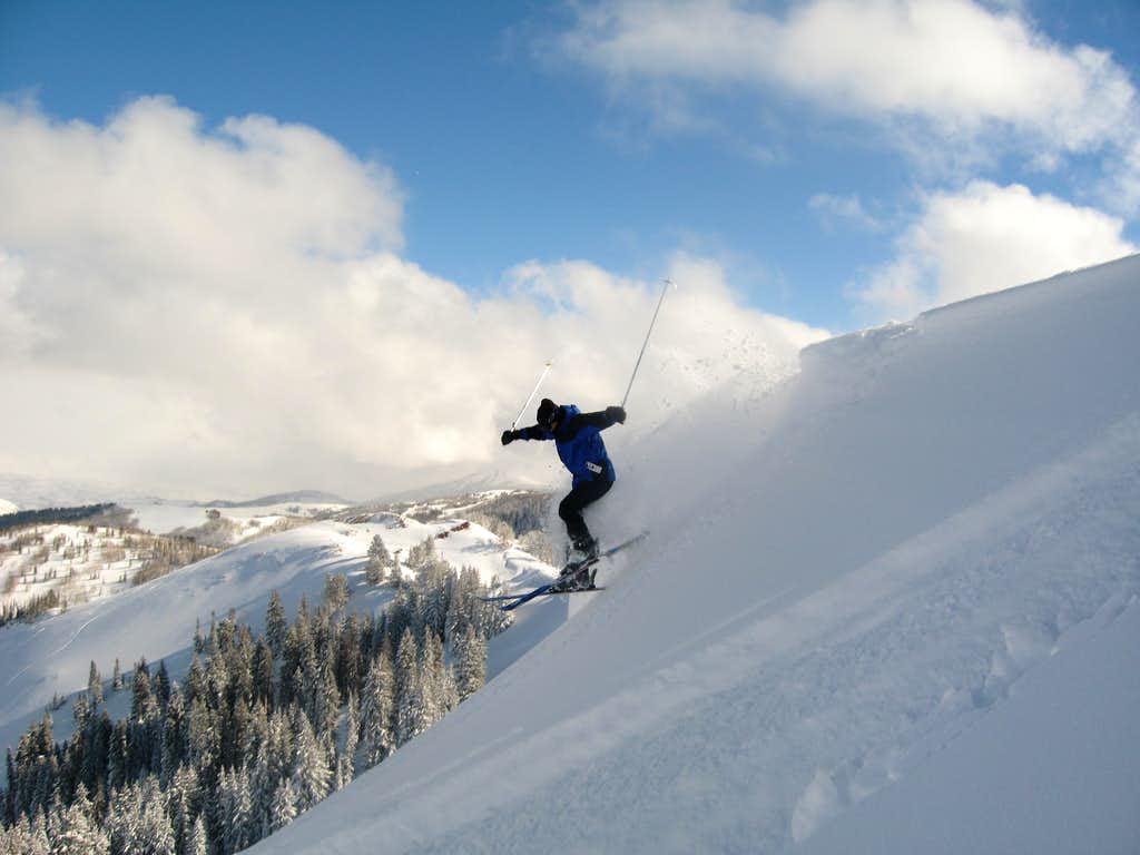 Skier drops into Dutch Draw from Silver Peak