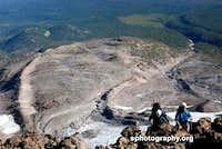Hotlum Glacier: west terminal moraine and climbers.