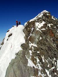 Descending from Kleinglockner wih summit Grossglockner in the background