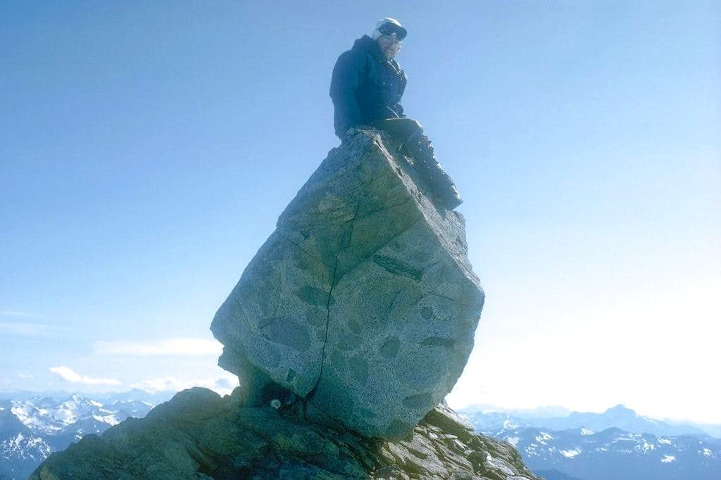 Yours truly sitting on Dome Peak's summit boulder
