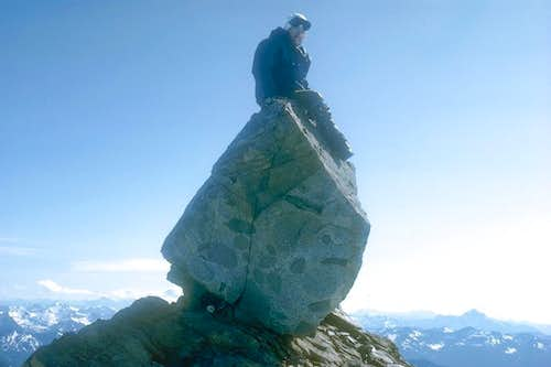 Yours truly sitting on Dome Peak\'s summit boulder