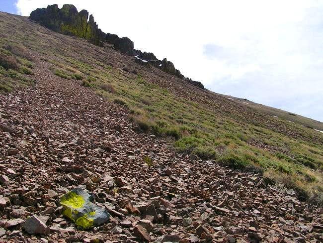 Looking up at talus slopes a...