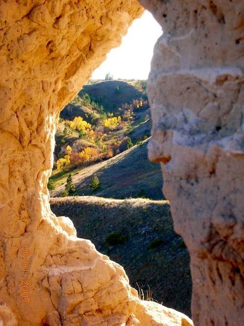 Fall colors through rock window
