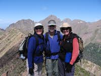 Sharon and Randy Breunlin and Cheryl Bradley at the summit of Marble
