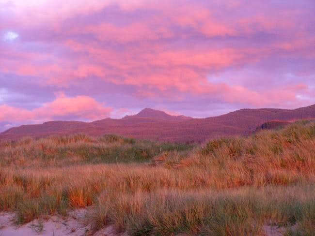 Pink skies at sunset over the...