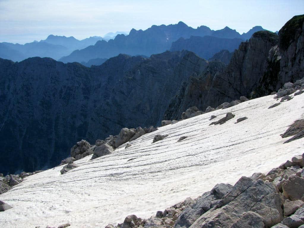 Summer snow at slopes of Mangart