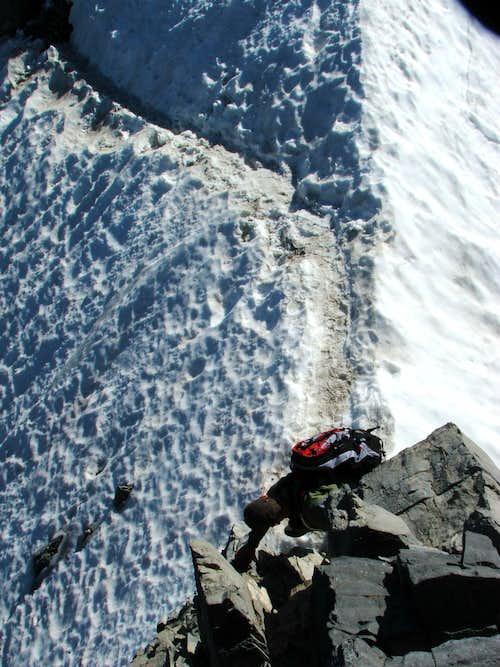 Pete downclimbing to snowbridge